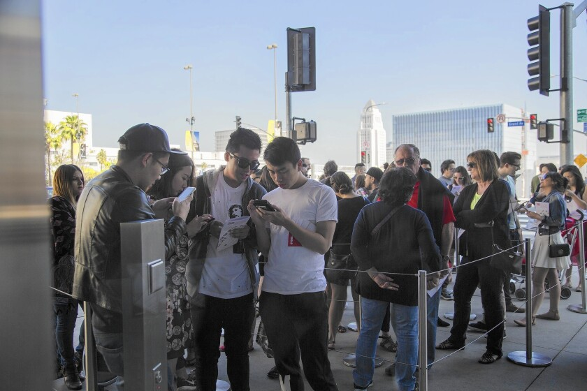 A crowd waits outside the Broad in downtown L.A.