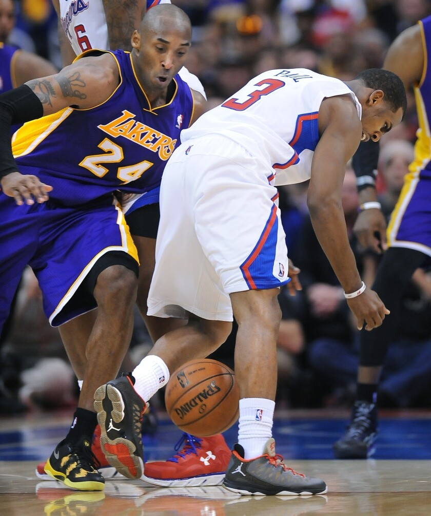 Lakers guard Kobe Bryant (24) strips the ball away from Clippers guard Chris Paul in the second half.