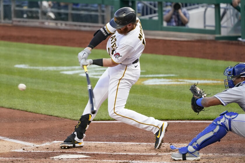 Pittsburgh Pirates' Colin Moran hits a single to drive in Bryan Reynolds from second in the first inning of a baseball game against the Kansas City Royals, Tuesday, April 27, 2021, in Pittsburgh. (AP Photo/Keith Srakocic)