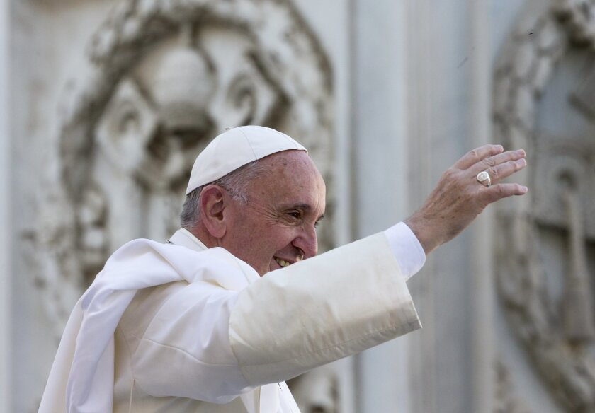 Pope Francis arrives for an audience with the Italian National Social Security Institute's workers (INPS), in St. Peter's Square at the Vatican, Saturday, Nov. 7, 2015.  (AP Photo/Alessandra Tarantino)