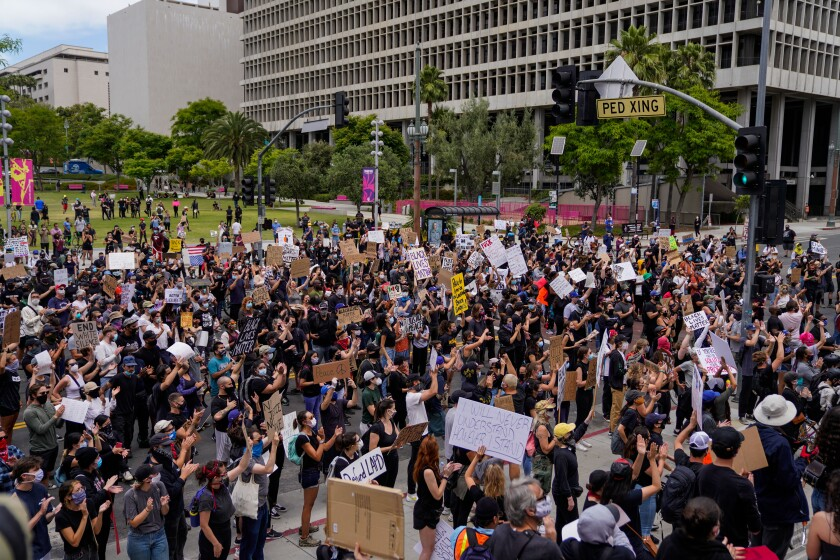 Protesters outside LA City Hall in downtown Los Angeles on Tuesday.