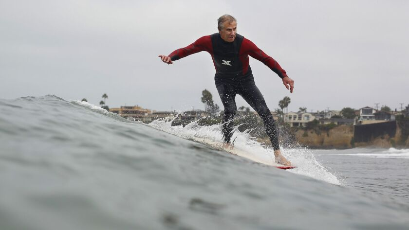 Ron Greene, 68, will be compete in the OMBAC 25th Annual Classic Longboard Surfing Contest in Pacific Beach this weekend.