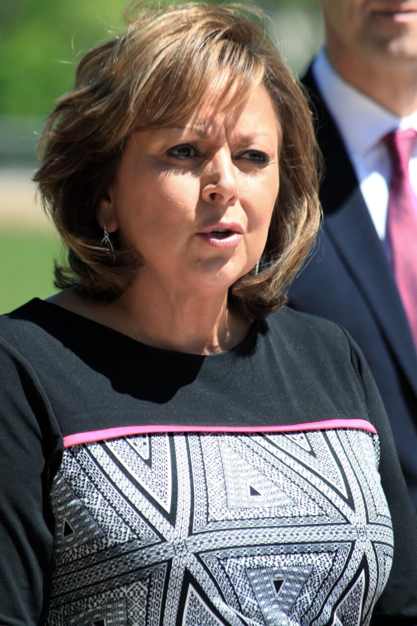 Gov. Susana Martinez announces a $73 million settlement between the state and the U.S. Department of Energy during a news conference in Albuquerque N.M., on Thursday, April 30, 2015. The settlement resolves a dispute over permit violations and fines that stemmed from a radiation release at the fede
