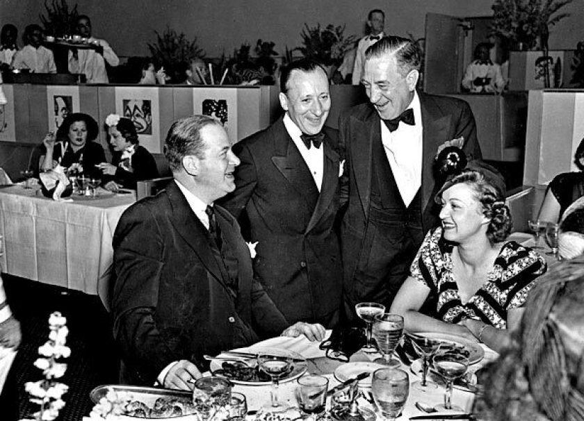"""Adolph """"Eddie"""" Brandstatter, center left, schmoozes with customers at Sardi's."""