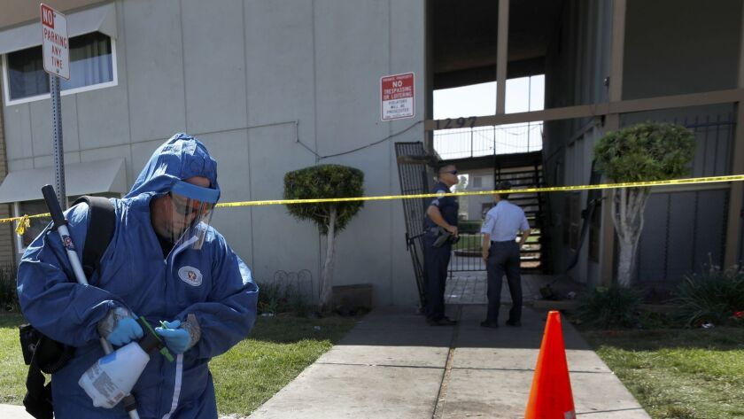 San Bernardino, CA SEPTEMBER 3, 2018: Damien Pomeroy cleans up the blood from a crime scene on the s
