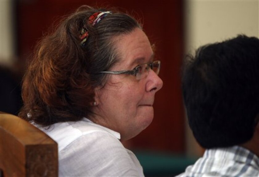 FILE - In this Jan. 7, 2013 file photo, Lindsay June Sandiford of Britain sits at a courthouse during her trial in Denpasar, Bali island, Indonesia. An Indonesian court upheld the death sentence against the British woman convicted of smuggling $2.5 million worth of cocaine into the resort island of Bali, a court official said Monday, April 8, 2013.(AP Photo/Firdia Lisnawati, File)
