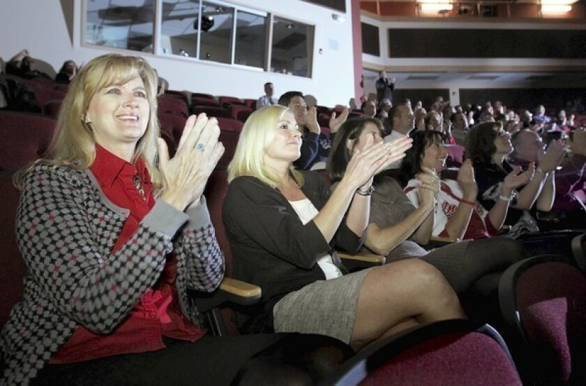 Teachers and administrators from the Corona-Norco Unified School District, including Washington Elementary Principal Bo Barnett, left, and Sierra Vista Elementary Principal Lara Gruebel, gather at Corona High School on Tuesday morning to watch a live stream of the announcement of this year's Broad Prize for Urban Education.