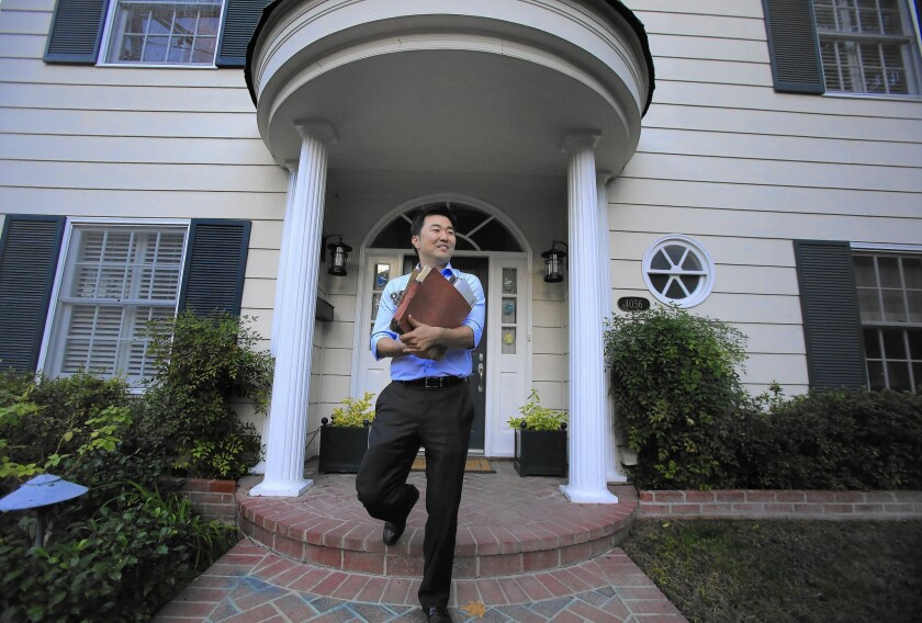 City Council candidate David Ryu leaves a home after visiting the homeowner in Sherman Oaks. Ryu has raised about $265,000, more than any of his rivals.