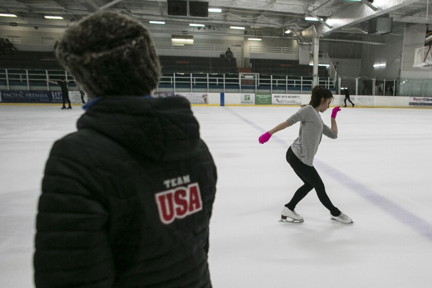 U.S. Olympic figure skater Ashley Wagner consults with Nadia Kanaeva during a practice session at The Rinks-Lakewood in 2016.