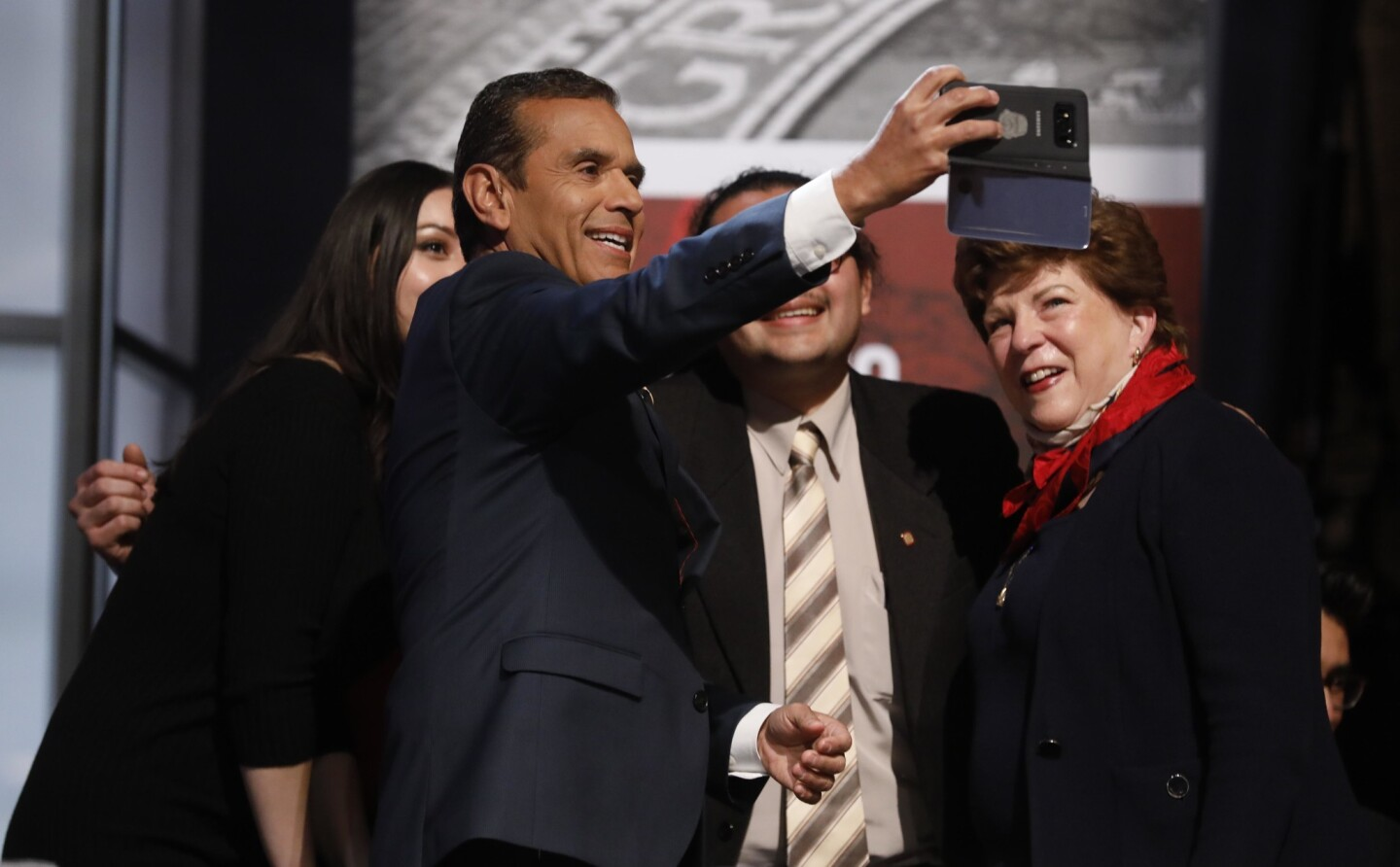 California gubernatorial candidates Antonio Villaraigosa and Delaine Eastin, right, take a picture before the debate at UCLA's Royce Hall.
