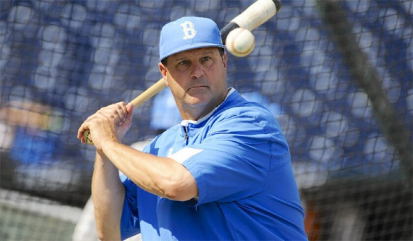 Baseball coach John Savage will remain with UCLA despite USC's attempt to woo him away.