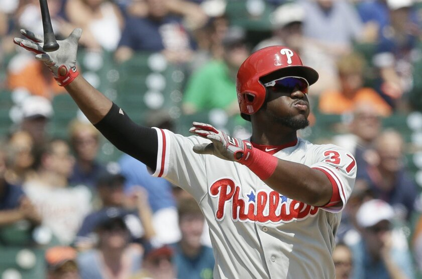 Philadelphia Phillies' Odubel Herrera follows through with a three-run home run during the fourth inning of a baseball game against the Detroit Tigers, Wednesday, May 25, 2016, in Detroit. (AP Photo/Carlos Osorio)