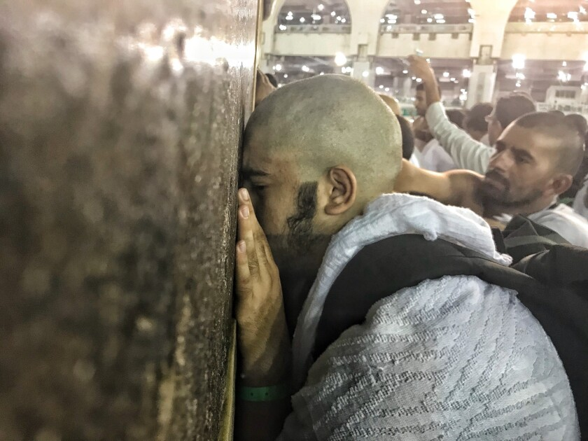 In 2018, Muslim Hajj pilgrims touch the wall of the Kaaba.