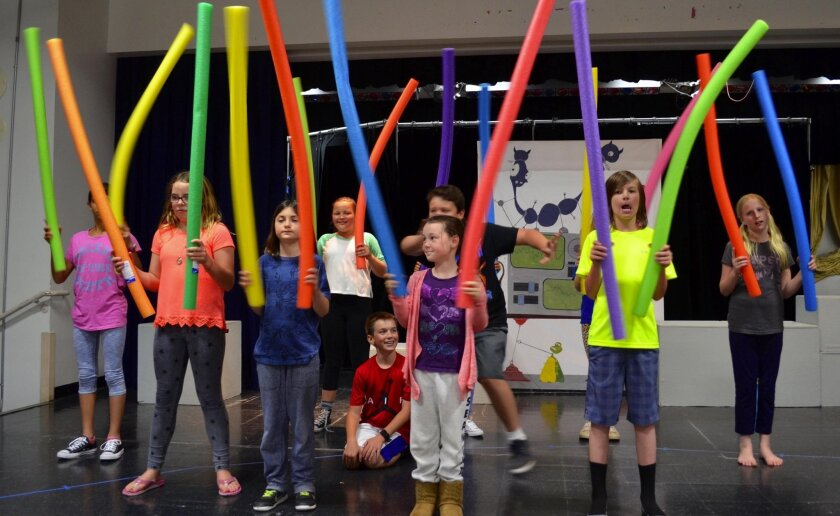 "Kids rehearse ""Bratty Brother in Outer Space,"" which will run 7 p.m. on Saturday, April 9 and 3 p.m. on Sunday, April 10 at Olivenhain Pioneer Elementary."
