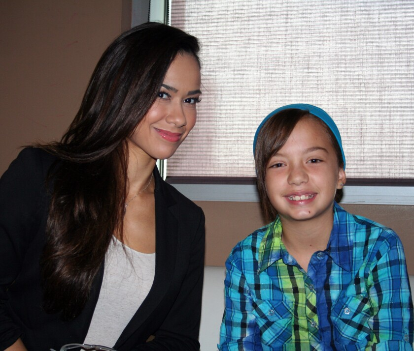 """""""Raw"""" General Manager AJ Lee and Hannah Mitchell."""