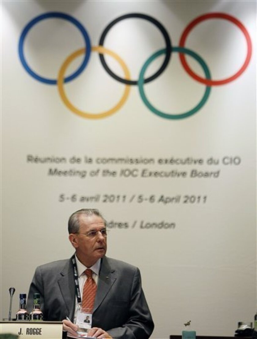 President of the IOC Jacques Rogge in conversation ahead of an IOC board meeting in London, Wednesday, April, 6, 2011. The British Olympic Association suspended its legal action against London 2012 organizers and is ready for fresh talks to resolve a messy financial dispute. The BOA has been pushing for a greater share of any surplus from the Olympics. Entitled to a 20 percent cut under a joint marketing agreement signed in 2005, the BOA claims that the potentially money-losing Paralympics should not be taken into account. The International Olympic Committee and London organizing committee, known as LOCOG, insist that the cost of both games should be counted, as they have been in the past.(AP Photo/Alastair Grant)