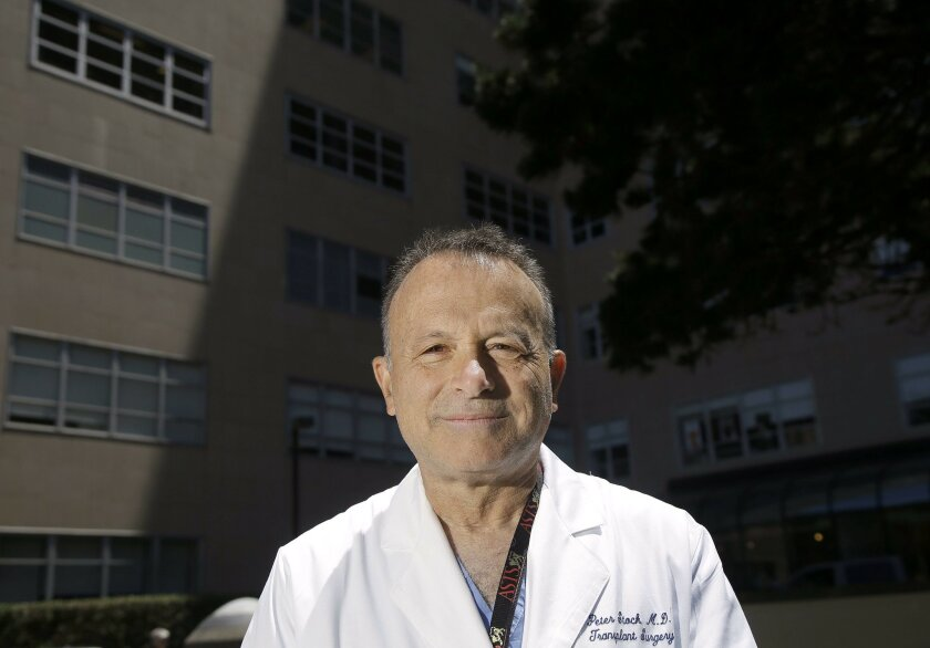 Dr. Peter Stock poses for photos on the University of California, San Francisco Medical Center campus in San Francisco, Friday, May 27, 2016. California lawmakers approved emergency legislation Friday to allow a man with HIV to receive part of his HIV-positive husband's liver before the surgery bec
