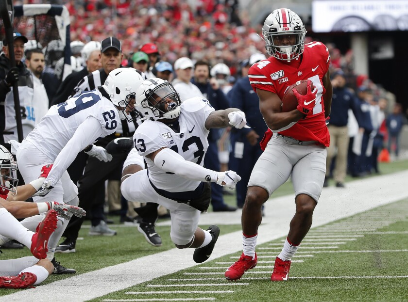 Ohio State receiver K.J. Hill Jr. makes a catch past Penn State linebacker Ellis Brooks (13) during the first quarter  Saturday.