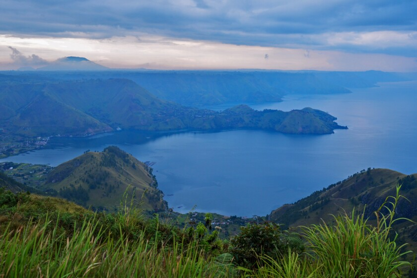 Lake Toba in Indonesia was formed 75,000 years ago after a violent volcanic eruption. It's now home to a large Christian minority, which is resisting plans to transform the region into a major Muslim tourist destination.
