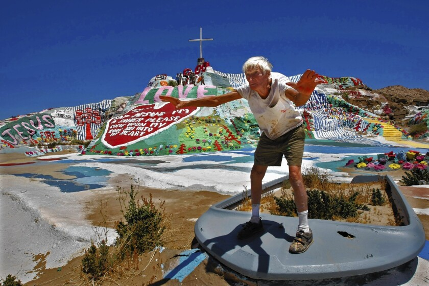 Leonard Knight works on Salvation Mountain in 2010. He used 500,000 gallons of paint, mostly donated by snowbirds, to create his masterpiece.