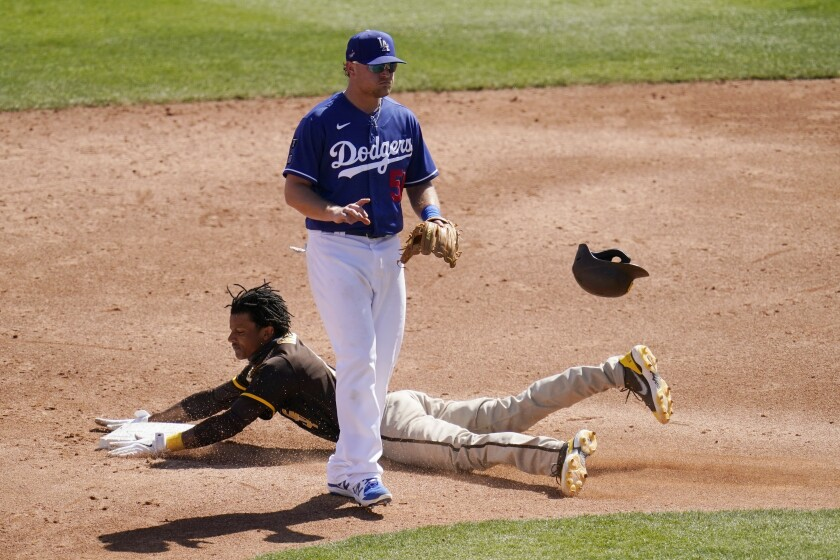 Padres' C.J. Abrams steals second base without a throw as Los Angeles Dodgers second baseman Sheldon Neuse watches.