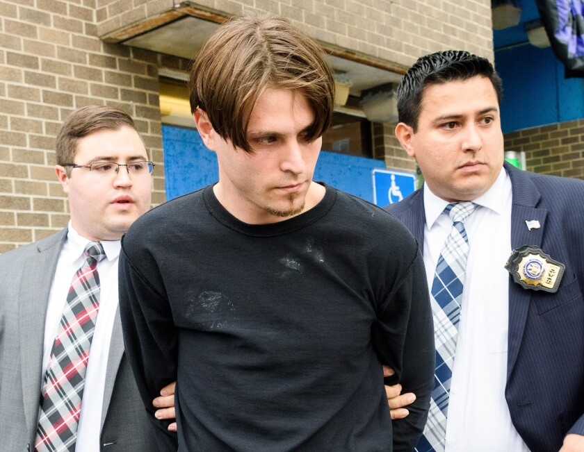 (Center) Matthew Wohlfahrt is led from the NYPD 68th Precinct station house in Brooklyn on Sunday. Wohlfahrt allegedly exposed himself to two young girls in Brooklyn.