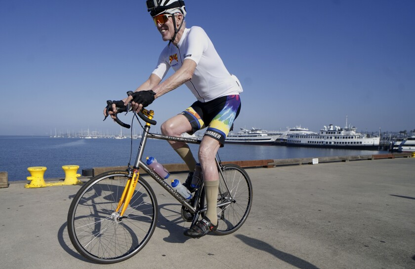 Former NBA star Bill Walton rides his bike during the Bike for Humanity on April 25.
