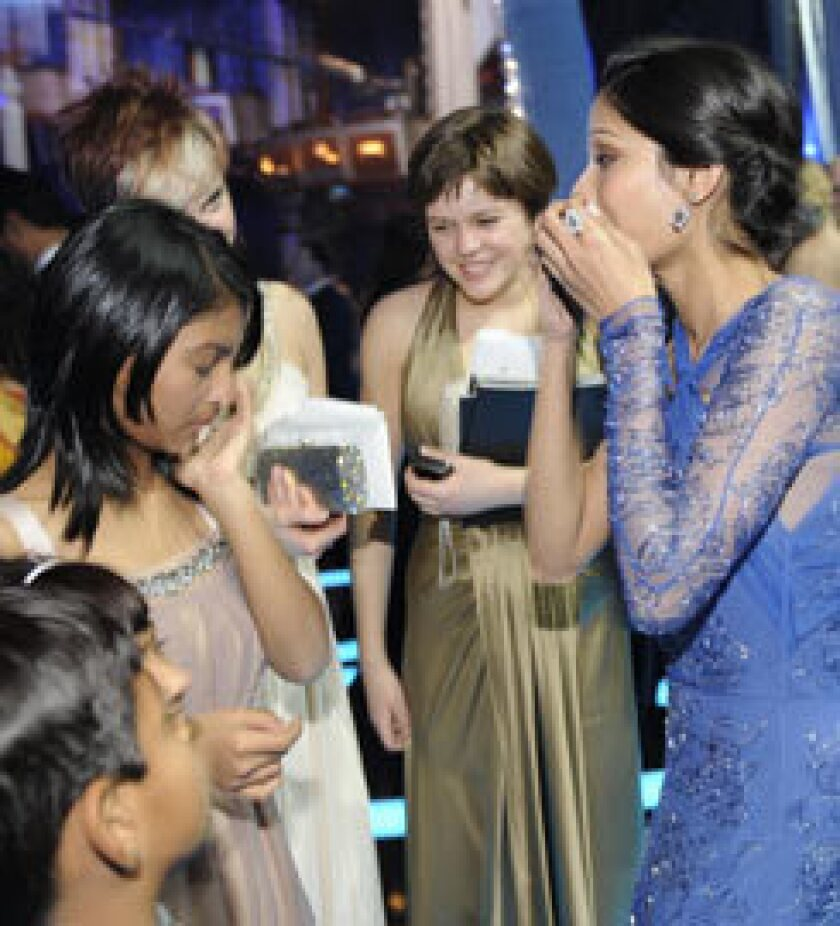 """""""Slumdog Millionaire"""" star Freida Pinto reacts to news of the film's best picture award. It also won for direction, adapted screenplay, cinematography, editing, original score, original song and sound mixing."""