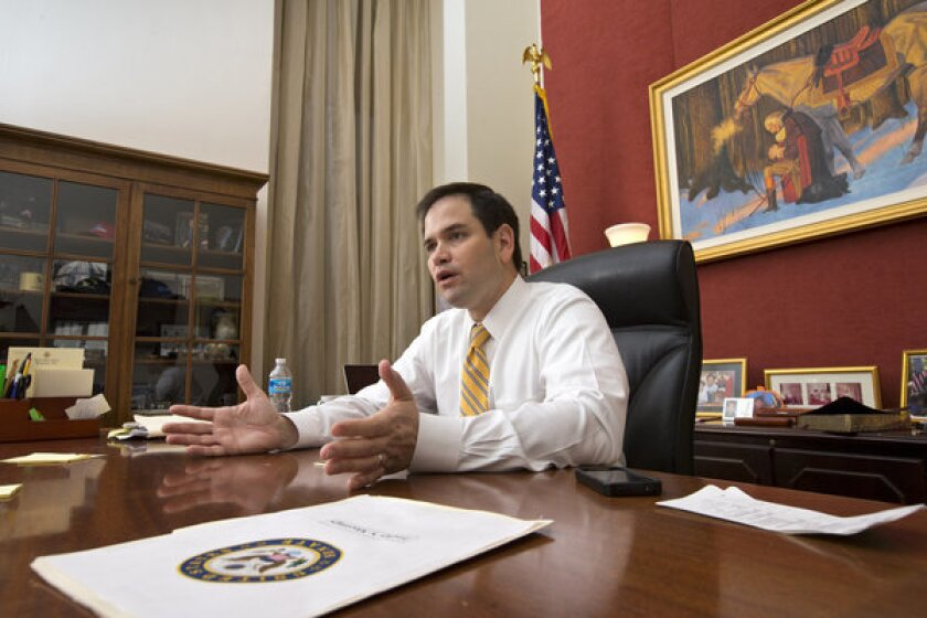 In the current debate over immigration reform, the immigrant story you're most likely to hear is that of the Cuban American senator from Florida, Republican Marco Rubio. Above: Rubio is seen in his Capitol Hill office in Washington on Feb. 7.