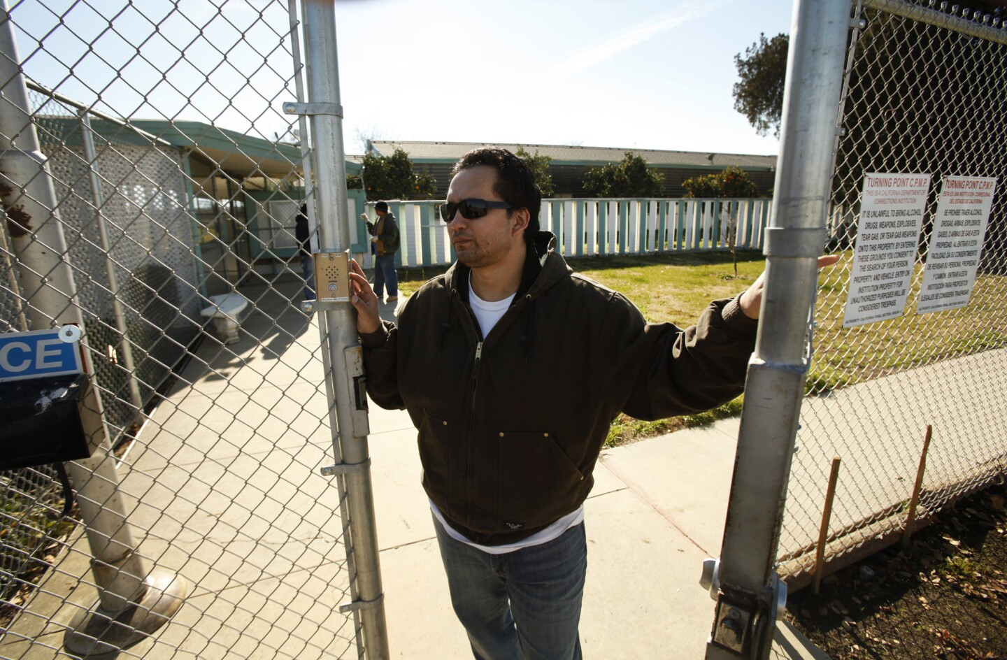 Jara stands at the front gate to Rockhill Farm near Bakersfield. He founded and runs the nonprofit, whose aim is to rehabilitate drug addicts and felons.