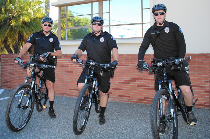 Sgt. Brent McKinley and Officers Trevor Jones and Daniel Holl, left to right, are among the new staff assigned part-time to Costa Mesa police's new bike patrol unit.