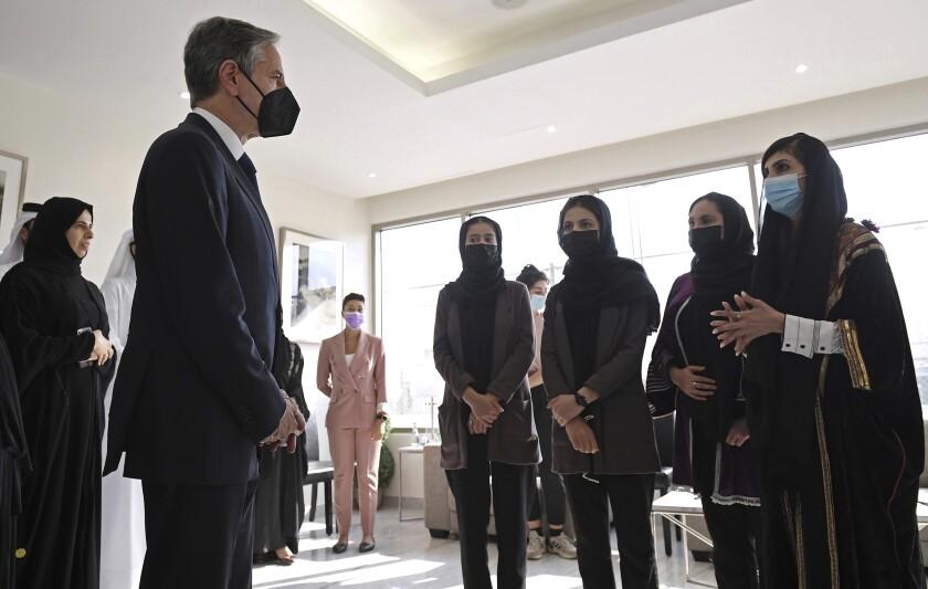 U.S. Secretary of State Antony Blinken meets with members of the exiled Afghan girls robotics team in Doha, Qatar.