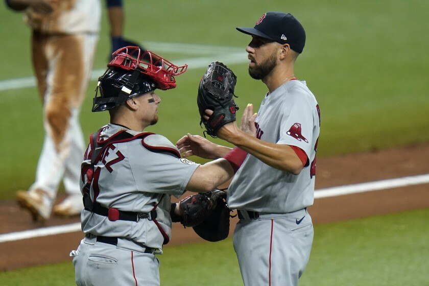 Boston Red Sox catcher Christian Vazquez, left, and pitcher Matt Barnes celebrate after clsoing out the Tampa Bay Rays during the ninth inning of a baseball game Thursday, Sept. 10, 2020, in St. Petersburg, Fla. (AP Photo/Chris O'Meara)