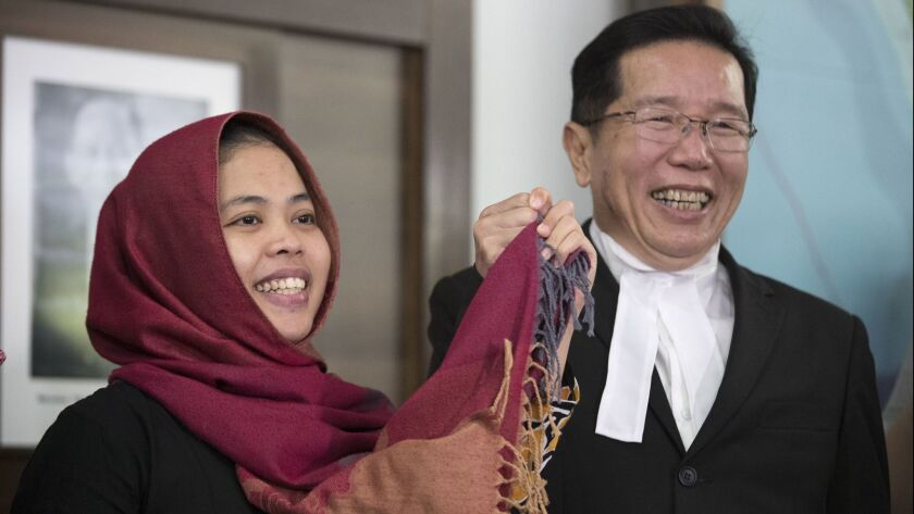 Siti Aisyah smiles with her lawyer Gooi Soon Seng after a news conference at the Indonesian Embassy in Kuala Lumpur, Malaysia, on March 11.