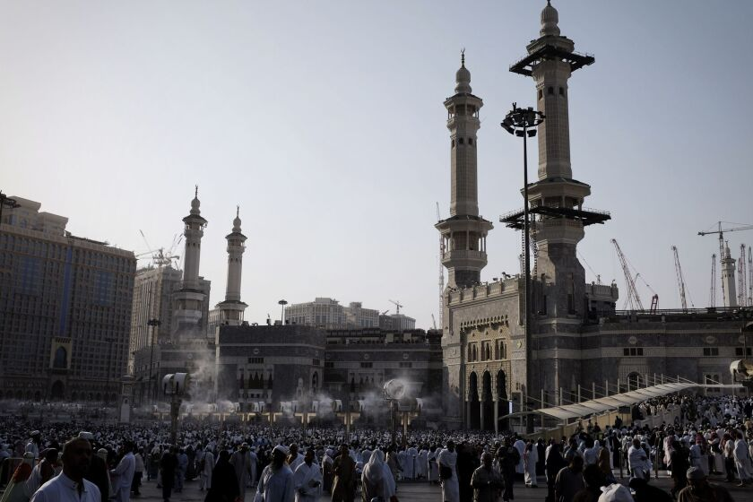 Muslim pilgrims arriving for the evening prayer Monday at the Grand Mosque in Mecca, Saudi Arabia, Islam's holiest site.