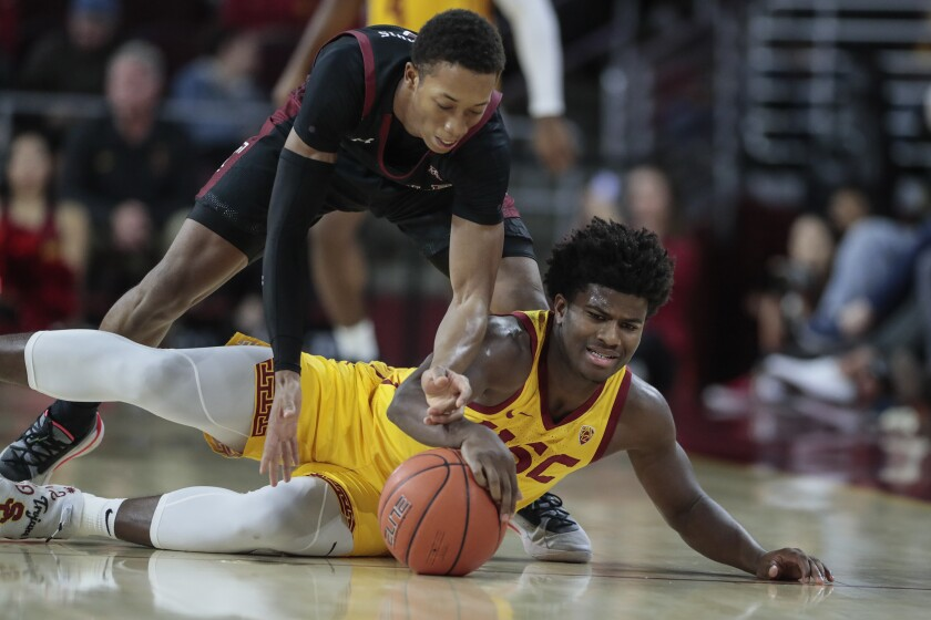 USC's Ethan Anderson battles Temple's Josh Pierre-Louis for a loose ball Nov. 22, 2019.