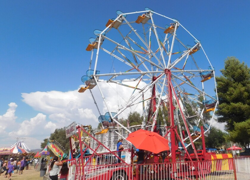 Ramona Country Fair visitors take a spin on the Ferris wheel and other rides.