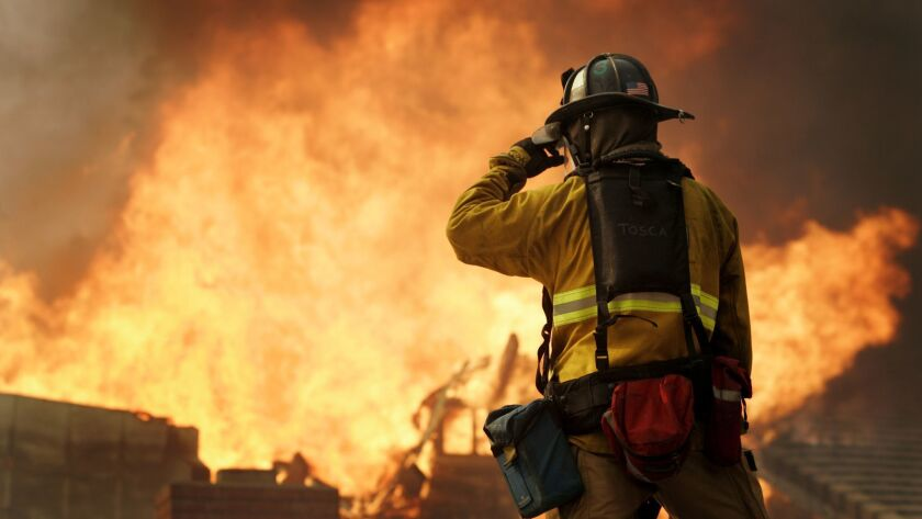 A firefighter at the 2007 wildfires that scorched the San Diego area that destroyed more than 1,300 homes, killed two people and injured 40 firefighters.