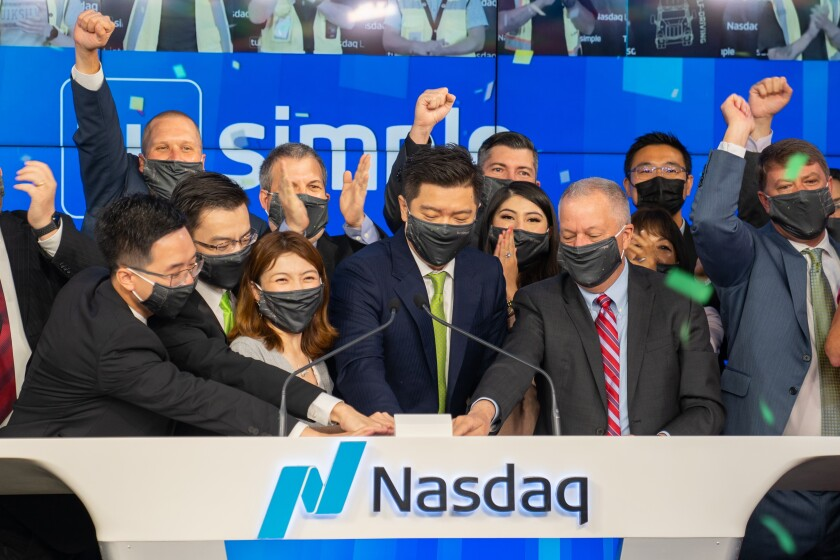TuSimple's executive team rings the bell Thursday when it listed on Nasdaq.