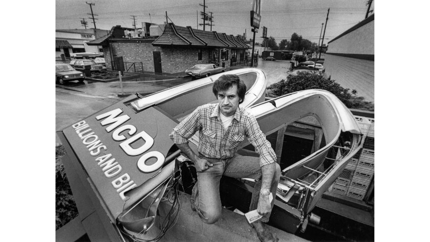 Sep. 12, 1984: Daniel Chadwick stands atop McDonald's sign he toppled in North Hollywood. The site w