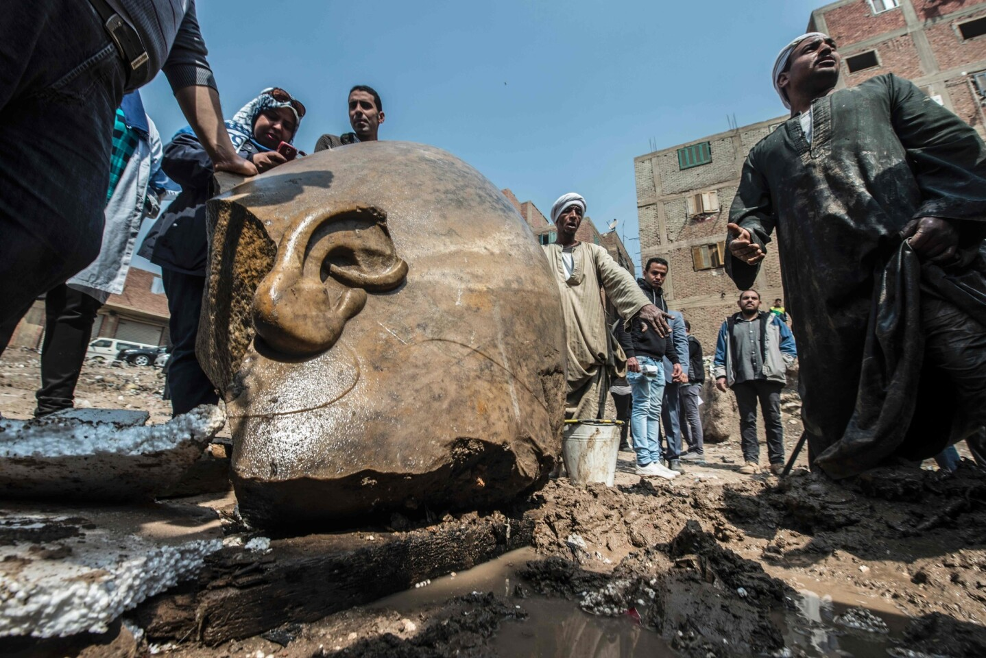Egyptian workers look at the site of a discovery by a team of German-Egyptian archaeologists in Cairo's Mattarya district. Statues of the kings and queens of the 19th dynasty (1295-1185 B.C.) were unearthed in the vicinity of the Temple of Ramses II in what was the old pharonic city.