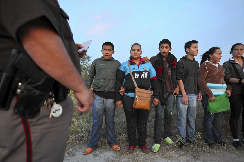 A deputy in Hidalgo County, Texas, questions a group of Guatemalans who had crossed the border at McAllen earlier this month. Many migrants are inadequately prepared for the harsh terrain.
