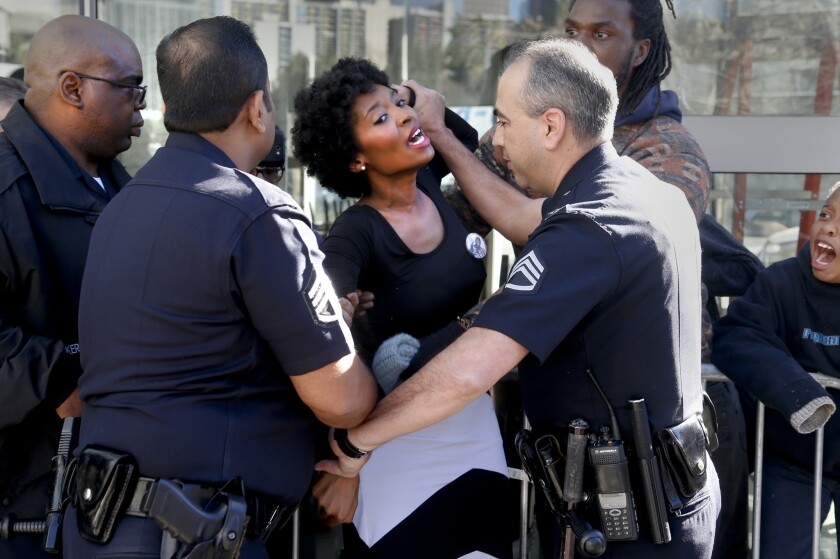 Sha Dixon, organizer for Black Lives Matter Los Angeles, is arrested by Los Angeles police Jan. 5.