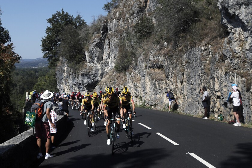 Team Jumbo - Visma riders lead the pack during the stage 15 of the Tour de France cycling race over 174 kilometers (108 miles), with start in Lyon and finish in Grand Colombier, Sunday, Sept. 13, 2020. (AP Photo/Christophe Ena)