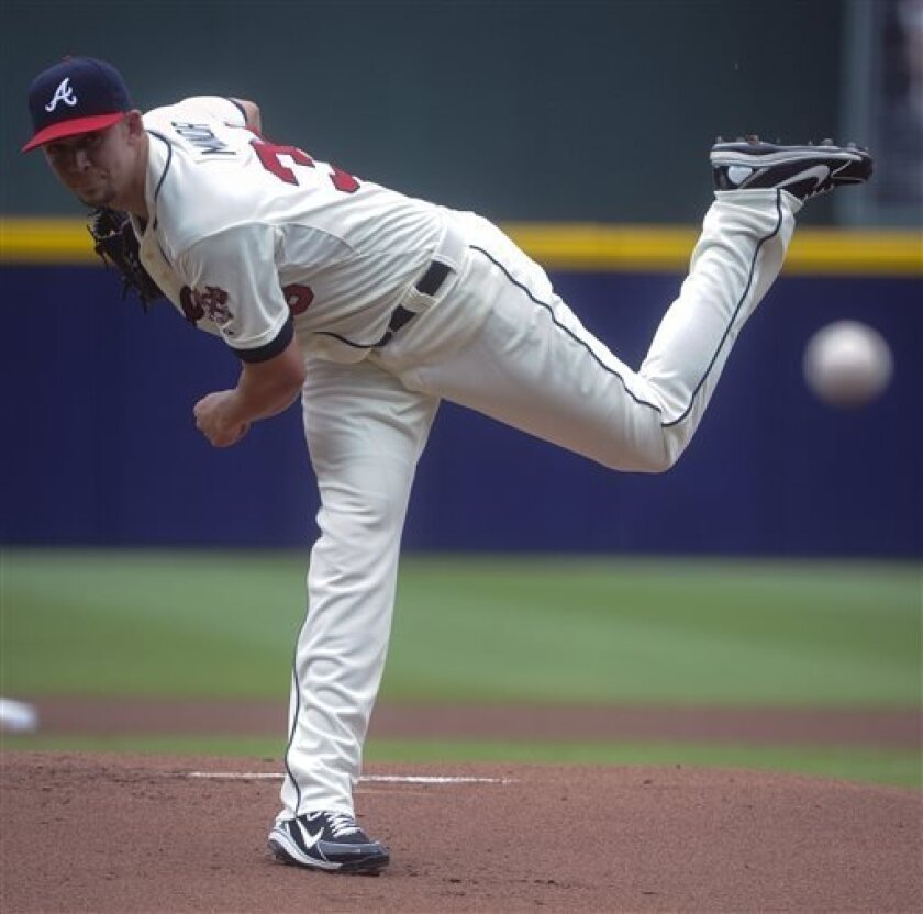 Atlanta Braves' Mike Minor delivers a pitch to the Cincinnati Reds during the first inning of a baseball game on Saturday, July, 13, 2013, in Atlanta. (AP Photo/John Amis)
