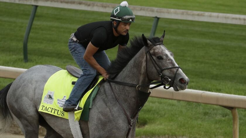 Kentucky Derby entrant Tacitus is ridden on the track during a workout at Churchill Downs Wednesday,