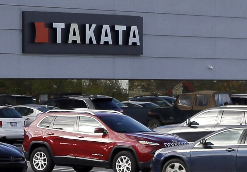 FILE - This Oct. 22, 2014, file photo shows the North American headquarters of automotive parts supplier Takata in Auburn Hills, Mich. Seven more companies including electric car maker Tesla Motors could be facing recalls because they use air bag inflators made by Takata Corp. (AP Photo/Carlos Osorio, File)