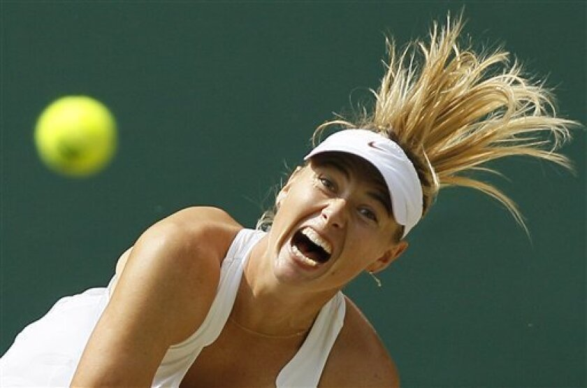 Russia's Maria Sharapova serves during the ladies' singles final against Petra Kvitova of the Czech Republic at the All England Lawn Tennis Championships at Wimbledon, Saturday, July 2, 2011. (AP Photo/Kirsty Wigglesworth)