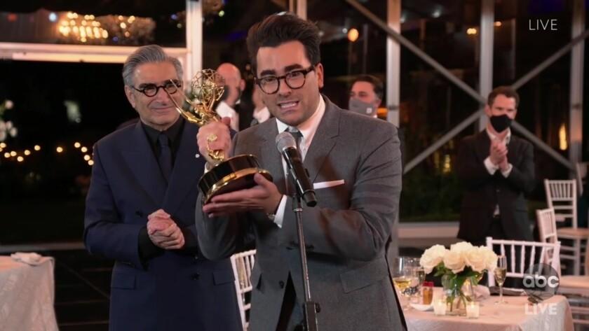Dan, right, and Eugene Levy won Emmys on Sunday.