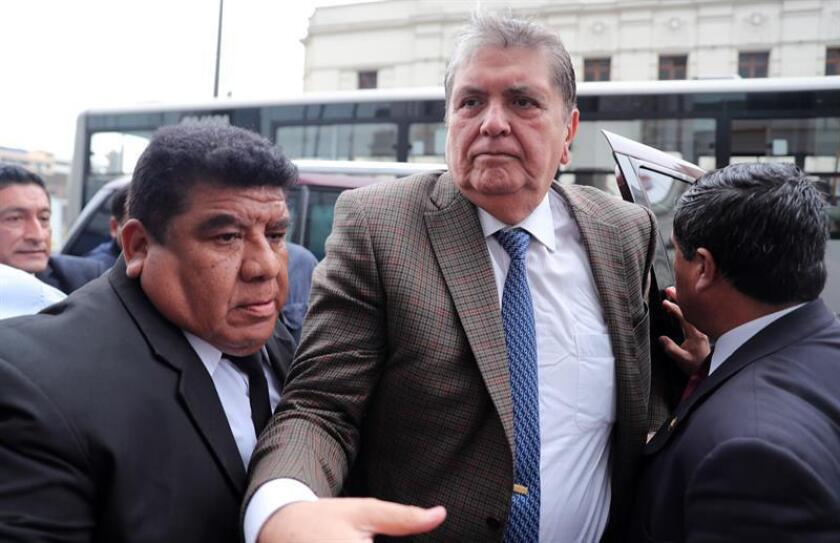 Former President Alan Garcia (C) arrives at the Peruvian Attorney General's Office in Lima, Peru, Nov. 15, 2018. EPA-EFE/Ernesto Arias